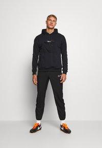 Nike Performance - HOODIE - Luvtröja - black/white - 1