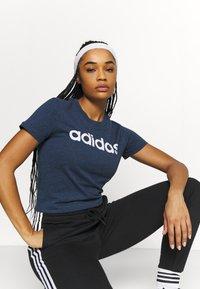 adidas Performance - T-shirts print - crname/white - 3