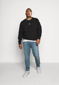 Levi's® Plus - 512 SLIM TAPER - Jeans Tapered Fit - pelican rust - 1
