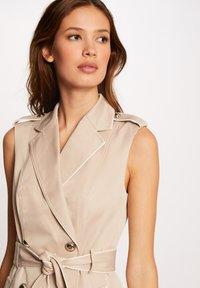 Morgan - BUTTONED SLEEVELESS WRAP  - Shirt dress - beige - 3