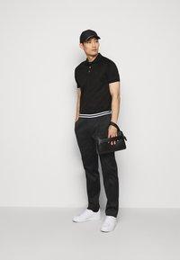 Emporio Armani - Kalhoty - black - 1