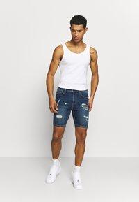 11 DEGREES - RIP AND REPAIR  - Denim shorts - mid blue - 1