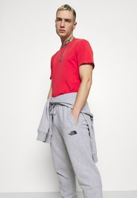 The North Face - JOGGER - Tracksuit bottoms - light grey heather