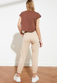 Trendyol - Tracksuit bottoms - brown - 2