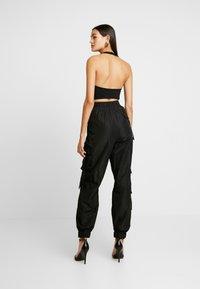 Tiger Mist - FLOSS PANT - Trousers - black - 2