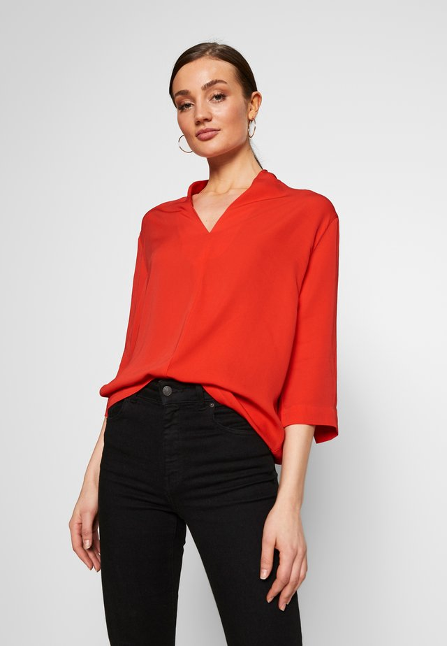 Blusa - flame red