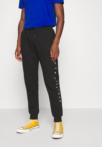 Tommy Hilfiger - BASIC BRANDED - Tracksuit bottoms - black - 0