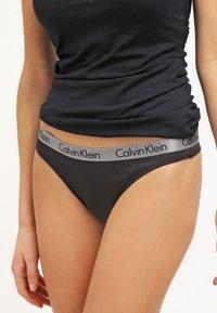Calvin Klein Underwear - RADIANT THONG - Thong - black - 0