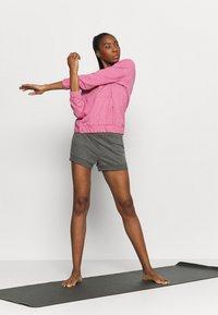 Nike Performance - CORE SHORT - Tracksuit bottoms - black/dark smoke grey - 1