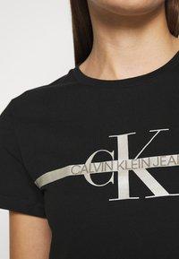 Calvin Klein Jeans - MONOGRAM TEE - Print T-shirt - black - 5