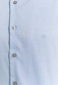 Calvin Klein Tailored - NATURAL STRETCH EXTRA SLIM SHIRT - Formal shirt - light blue - 2