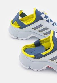 adidas Performance - TERREX HYDROTERRA UNISEC - Hiking shoes - crew blue/footwear white/acid yellow - 5