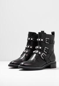 Tamaris - Cowboy/biker ankle boot - black - 4