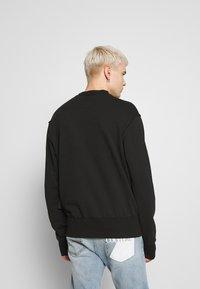 Versace Jeans Couture - LOGO GIOIELLI  - Mikina - black - 2