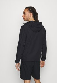 Under Armour - Windbreaker - black - 2