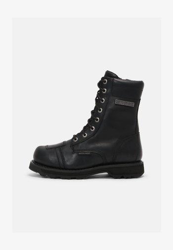 EDGERTON - Lace-up ankle boots - black
