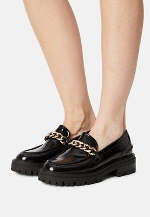 Slip-ons - black patent