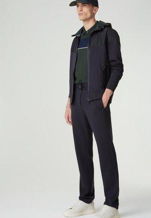 Polo shirt - dunkelgrün/navy-blau