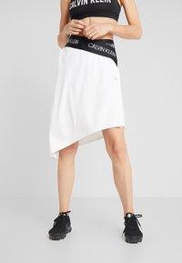 Calvin Klein Performance - ASYMMETRIC SKIRT - Sports skirt - white - 0