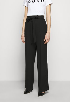 HOVIANA - Trousers - black
