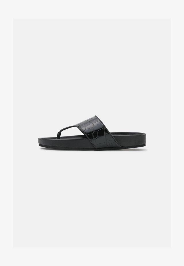 HARMONEE - T-bar sandals - black