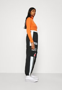 Ellesse - OLTUS TRACK PANT - Pantalones deportivos - black - 4