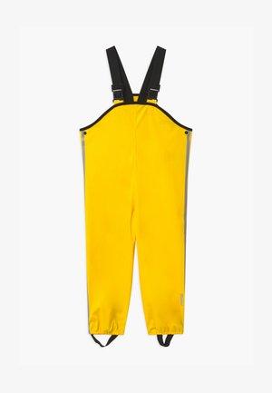LAMMIKKO - Pantalon de pluie - yellow