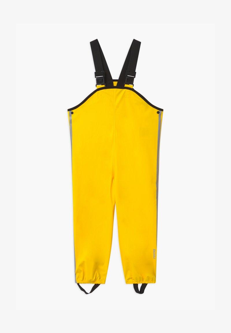 Reima - LAMMIKKO - Rain trousers - yellow