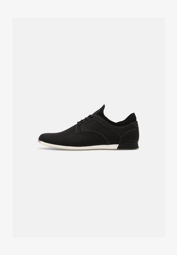 CORUCHE - Zapatillas - black