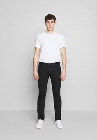 HUGO - Slim fit -farkut - black - 1