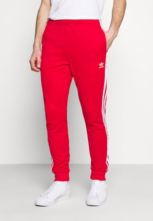 UNISEX - Tracksuit bottoms - scarle/white