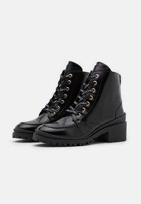 Nubikk - JANE VELAS - Lace-up ankle boots - black mirror - 2