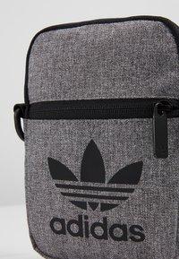 adidas Originals - MEL FEST BAG - Across body bag - black/white - 7
