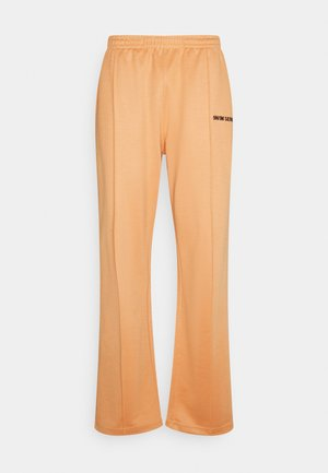 LOGO PANTS UNISEX - Bukser - pantone apricot/black