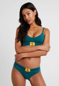 Calvin Klein Underwear - MONOGRAM UNLINED TRIANGLE - Bustier - dark green/orange - 1