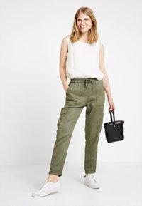 Opus - MUNDINI - Trousers - oliv green - 2