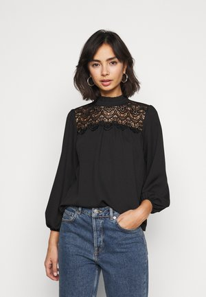 RUFFLE NECK YOKE - Button-down blouse - black