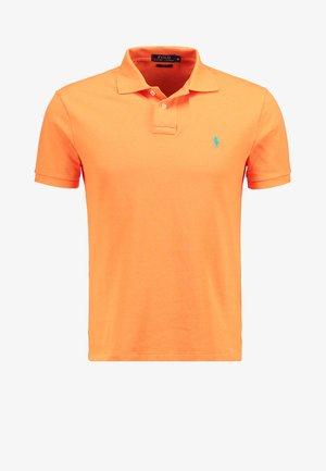 SLIM FIT MODEL - Polotričko - flare orange