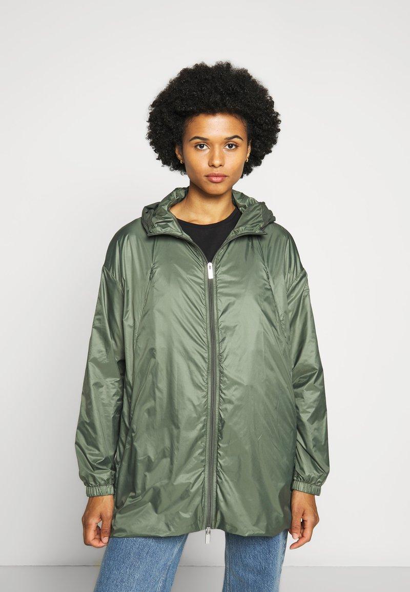 PYRENEX - WATER REPELLENT AND WINDPROOF - Waterproof jacket - jungle