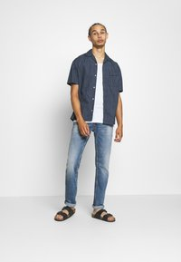 Replay - ROCCO - Straight leg jeans - light blue - 1