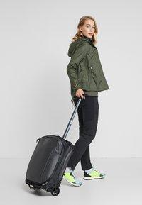 Osprey - CARRY ON  - Wheeled suitcase - black - 1
