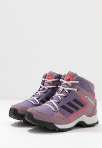 adidas Performance - TERREX HYPERHIKER TRAXION HIKING SHOES - Outdoorschoenen - tech purple/core black/shock red - 3