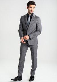 Calvin Klein Tailored - BARI SLIM FIT - Formal shirt - black - 1