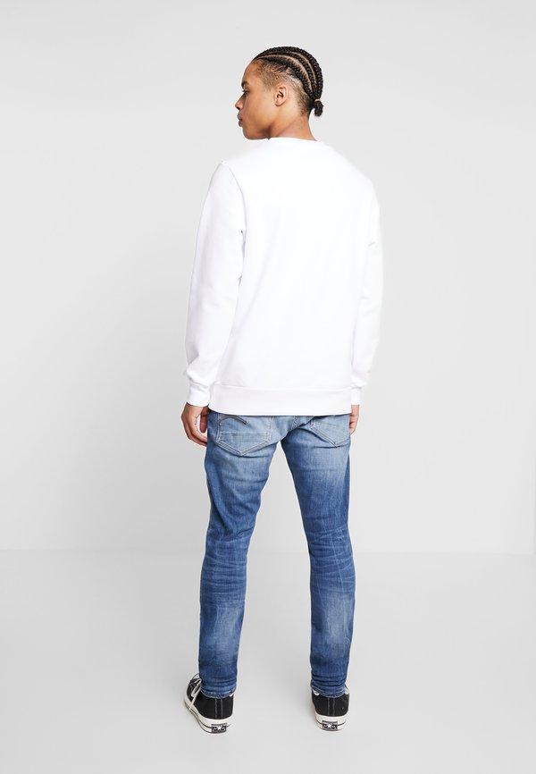G-Star REVEND SKINNY - Jeansy Slim Fit - medium indigo/niebieski denim Odzież Męska ODBS