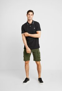 Timberland - TIPPED - Polo shirt - black - 1