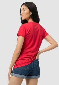 Jack Wolfskin - NAVIGATION - Print T-shirt - tulip red - 1