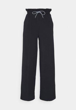 INFUSE PAPERBAG PANTS - Verryttelyhousut - black
