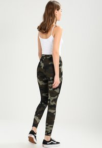 Urban Classics - LADIES CAMO TECH - Leggings - wood/black - 2