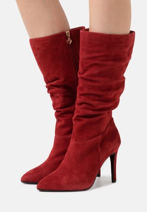 High heeled boots - ruby