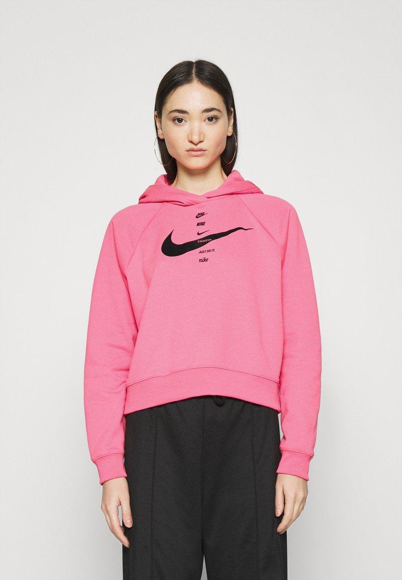 Nike Sportswear - HOODIE - Jersey con capucha - pink glow/black